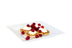 Pancakes with mascarpone and raspberries. Topped with honey Stock Images