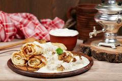 Pancakes with meat, mushrooms and sour cream sauce. Maslenitsa. Pancakes with meat, mushrooms and sour cream sauce. Traditional Russian cuisine. Maslenitsa stock photography