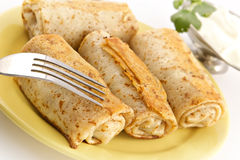 Pancakes with a meat stuffing royalty free stock images