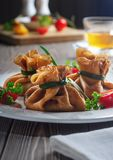 Pancakes with meat, tied with green onions stock image