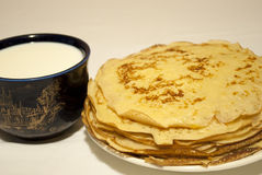 Pancakes and milk Royalty Free Stock Image