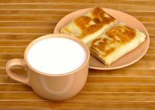 Pancakes and milk Stock Photos
