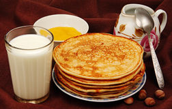 Pancakes with milk. Stock Photos