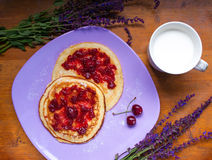 Pancakes and milk for breakfast stock images