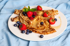 Pancakes with mint, strawberries, raspberries, Royalty Free Stock Images