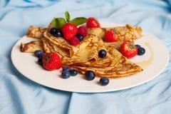 Pancakes with mint, strawberries, raspberries, Stock Photos