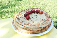 Pancakes with mirabelles Royalty Free Stock Images