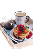 Pancakes with mixed berries isolated on white Stock Photos
