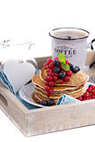 Pancakes with mixed berries isolated on white Stock Images