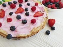Pancakes morning berries, raspberries, blueberries, breakfast strawberry yogurt on a wooden background. Pancakes with berries raspberries blueberries, strawberry Stock Image