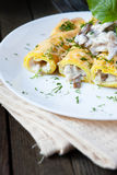 Pancakes with mushrooms and cream sauce Stock Images