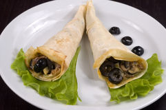 Pancakes with mushrooms and olives. Pancakes with mushrooms, olives and green salad Stock Images