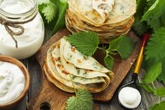 Pancakes with nettle stock image