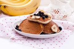 Pancakes with oatmeal, banana and blueberries Stock Image