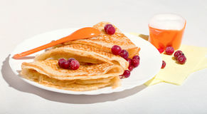 Free Pancakes On A White Plate, With Berries Of A Cranberry And Cream Royalty Free Stock Image - 65990576
