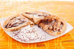 Pancakes on orange background Royalty Free Stock Images