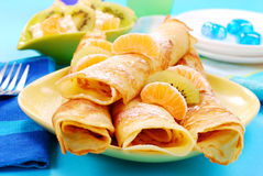 Pancakes with orange and kiwi Royalty Free Stock Images