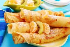 Pancakes with orange and kiwi Stock Image