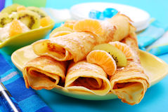 Pancakes with orange and kiwi Stock Image
