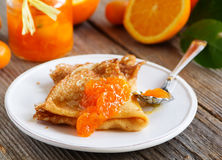 Pancakes with orange marmalade. Stock Photos