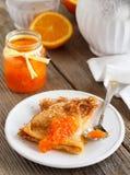 Pancakes with orange marmalade. Royalty Free Stock Image