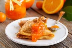 Pancakes with orange marmalade. Stock Images