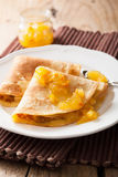 Pancakes with orange marmalade Stock Image