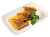 Pancakes in orange sauce with ice cream Royalty Free Stock Images