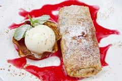 Pancakes with Orange Sauce and Ice Cream Stock Image