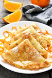 Pancakes with orange syrup Stock Photography