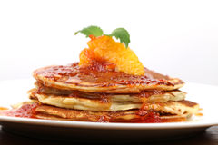 Pancakes with oranges Stock Images