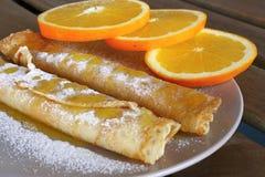 Pancakes with oranges Stock Photos