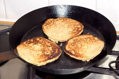 Pancakes in Pan Stock Photo