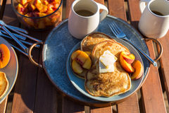 Pancakes with peaches Royalty Free Stock Photography