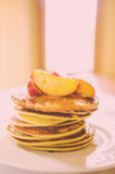 Pancakes with peaches and honey Stock Photos