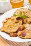 Pancakes with peaches and honey for breakfast, close-up Royalty Free Stock Photography