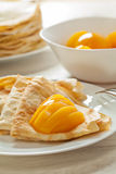 Pancakes with peaches served Stock Photo