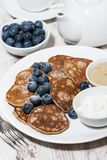 pancakes with peanut butter and yoghurt on white background stock image