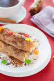Pancakes with pineapple filling and grated chocolate Stock Photos