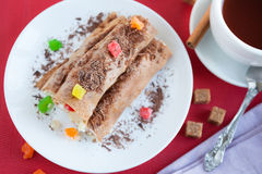 Pancakes with pineapple stuffing and grated chocolate Royalty Free Stock Images