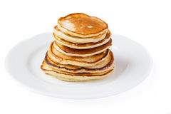 Pancakes on a plate. Isolated pancakes on a plate Stock Photography