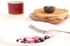 Pancakes on a plate with black currant jam Royalty Free Stock Photography