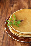 pancakes on a plate on a brown background Stock Images