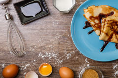 Pancakes on plate chocolate topping Royalty Free Stock Images