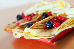 Pancakes on plate with cranberries and blueberries Royalty Free Stock Image