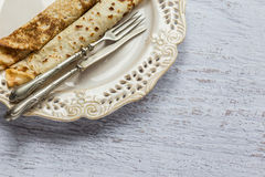 Pancakes in plate with fork and knife Royalty Free Stock Photos