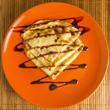 Pancakes on a plate orange watered chocolate Stock Image