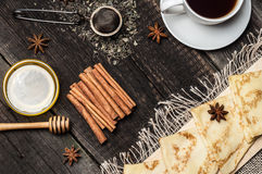 Pancakes on a plate, tea and spices Royalty Free Stock Photos