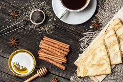 Pancakes on a plate, tea and spices Royalty Free Stock Image