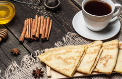 Pancakes on a plate, tea and spices Stock Image